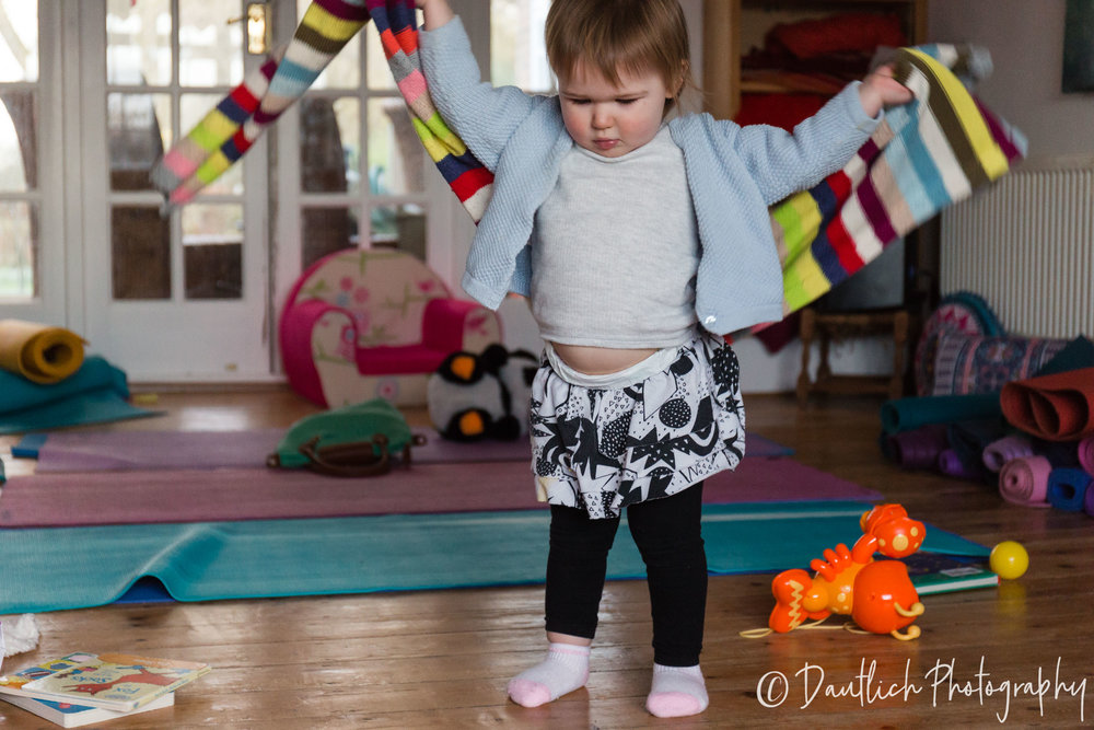 Hazel is dancing around the yoga studio with momma's scarf