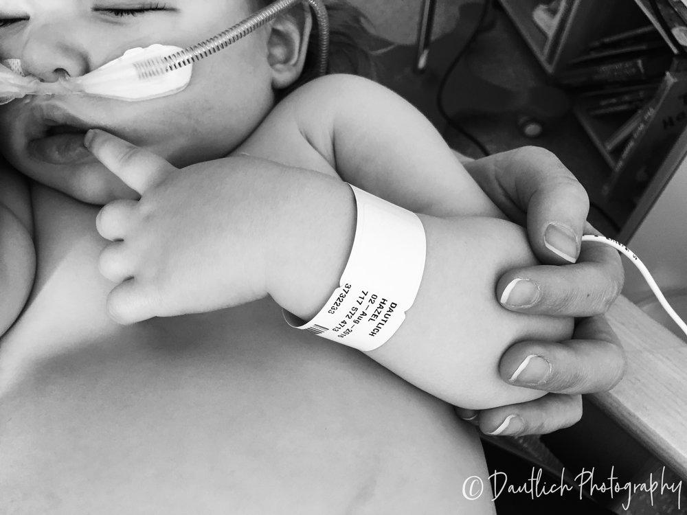 Hazel sleeps on mom in hospital