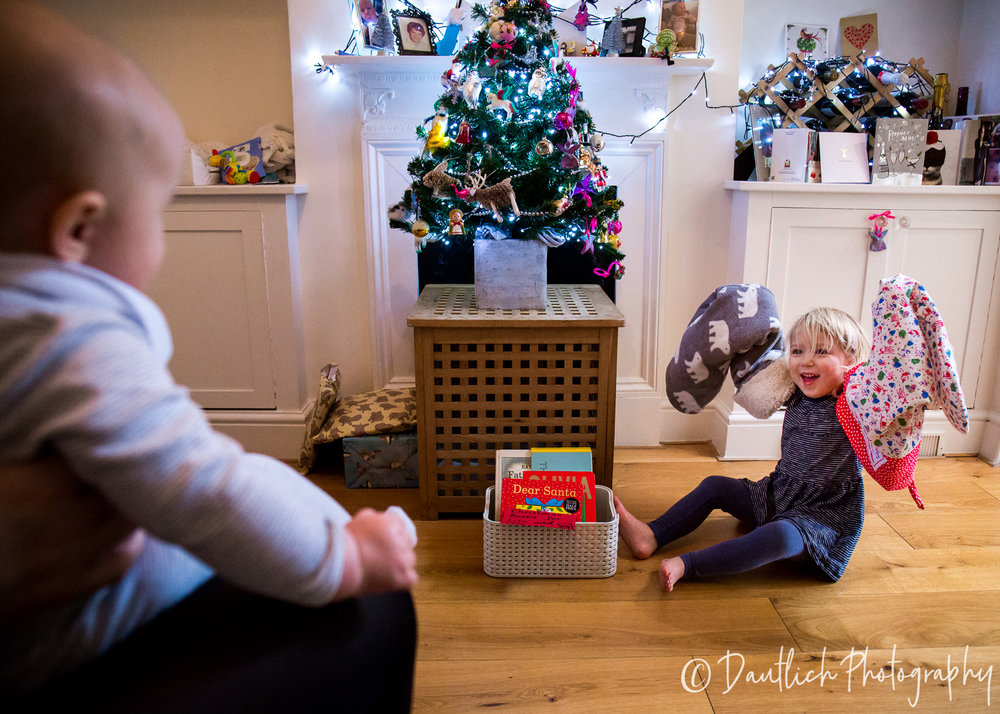 """Having these photos helps me to embed memories about this Christmas, when my children are nearly 3 and 6 months old. I'll remember the excitement and the magic of this time by looking at these photos, especially the shots of Lila playing with her stockings, showing us her favourite decorations on the tree, and generally being an excited scamp!"""