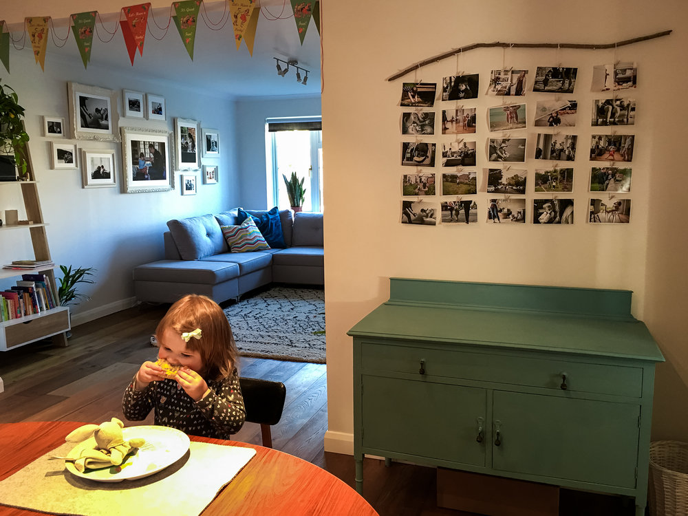 The real life view of our stick photo gallery in our house. (aka toddler eating)