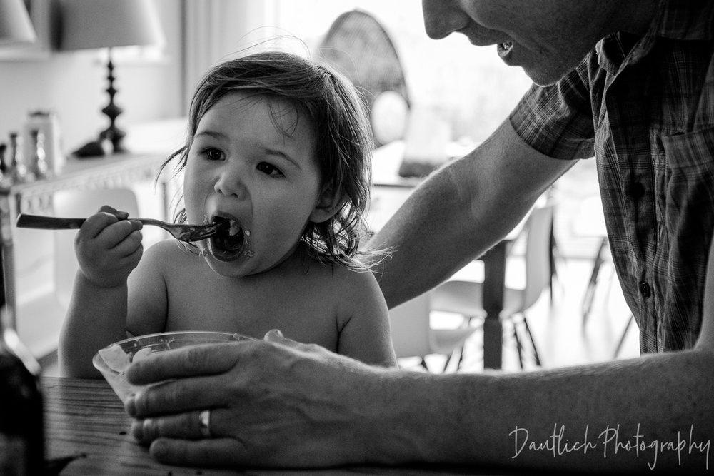 Hazel eats dinner with papa