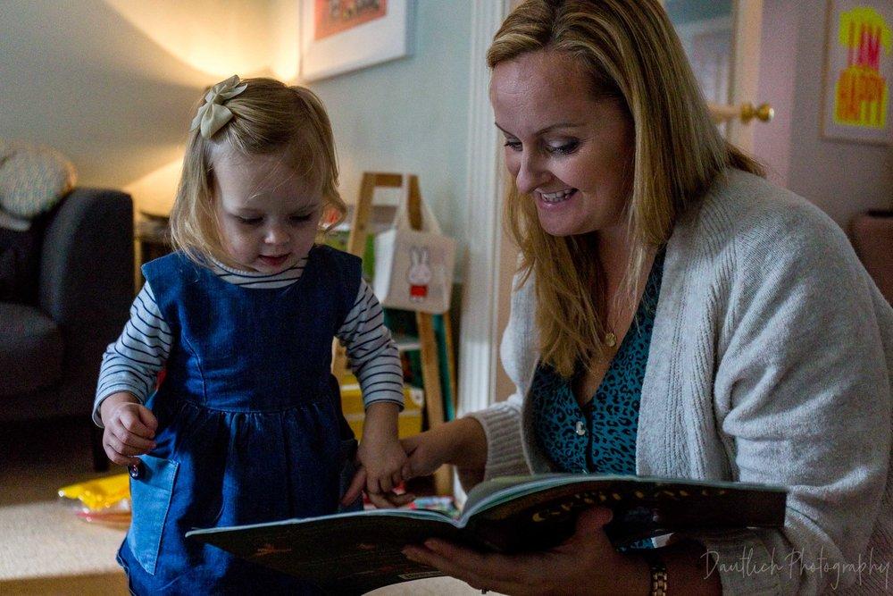 mum reads to toddler