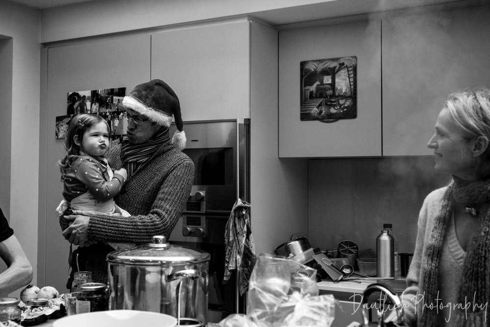 Uncle Marc making silly faces with Hazel as they cook Christmas dinner together in West Dulwich, London.