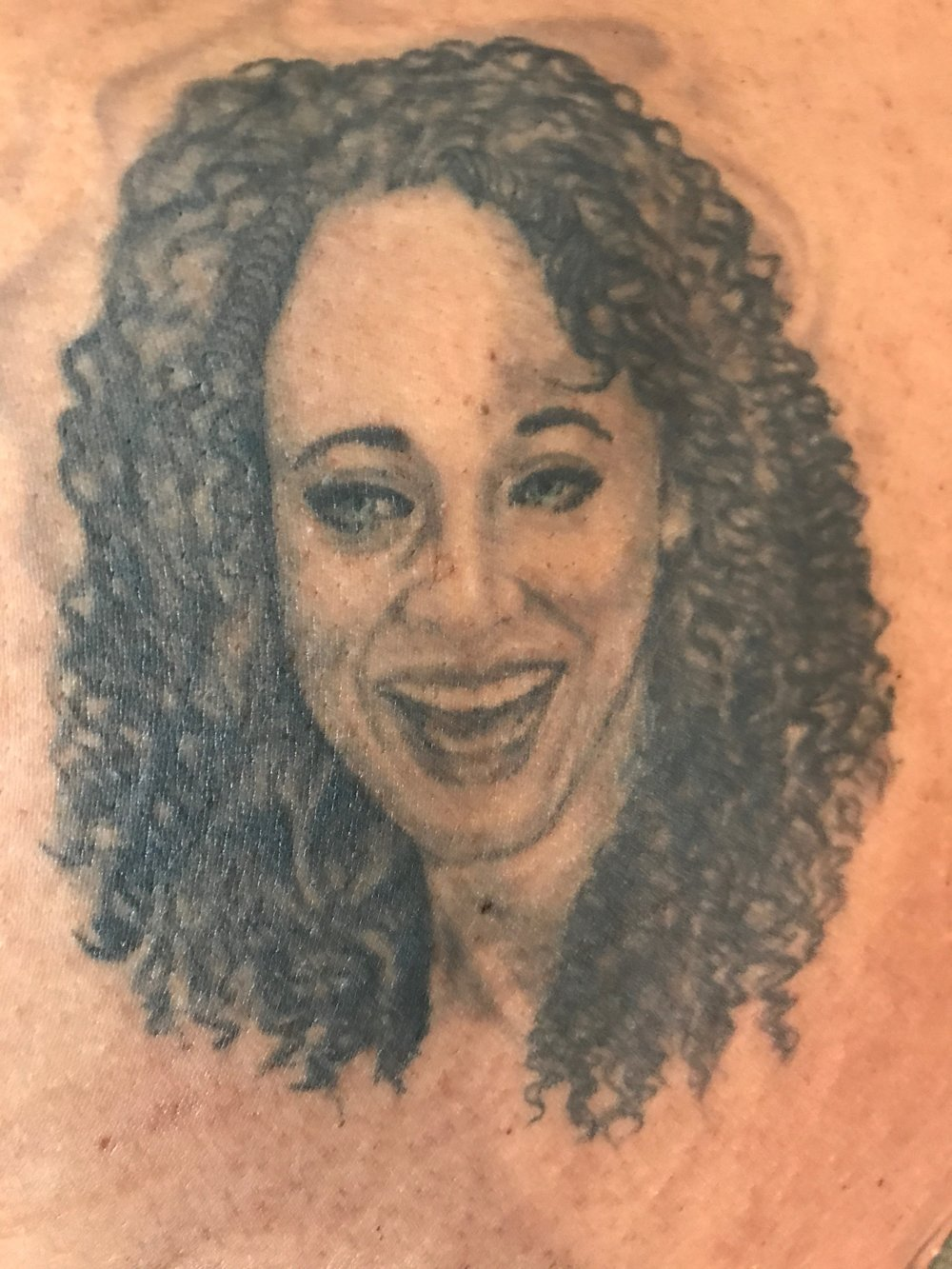 This is a portrait of my lovely daughter Sydney Cole Alexander. It was started by someone who I could only describe as a triple murderer; at least he claimed he was. He did a crappy job. Of course I didn't tell him that. A very talented artist at the Tattoo Factory in Chicago used his skills to save it.