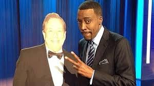 Arsenio with cardboard cut out of Donald Sterling.jpg
