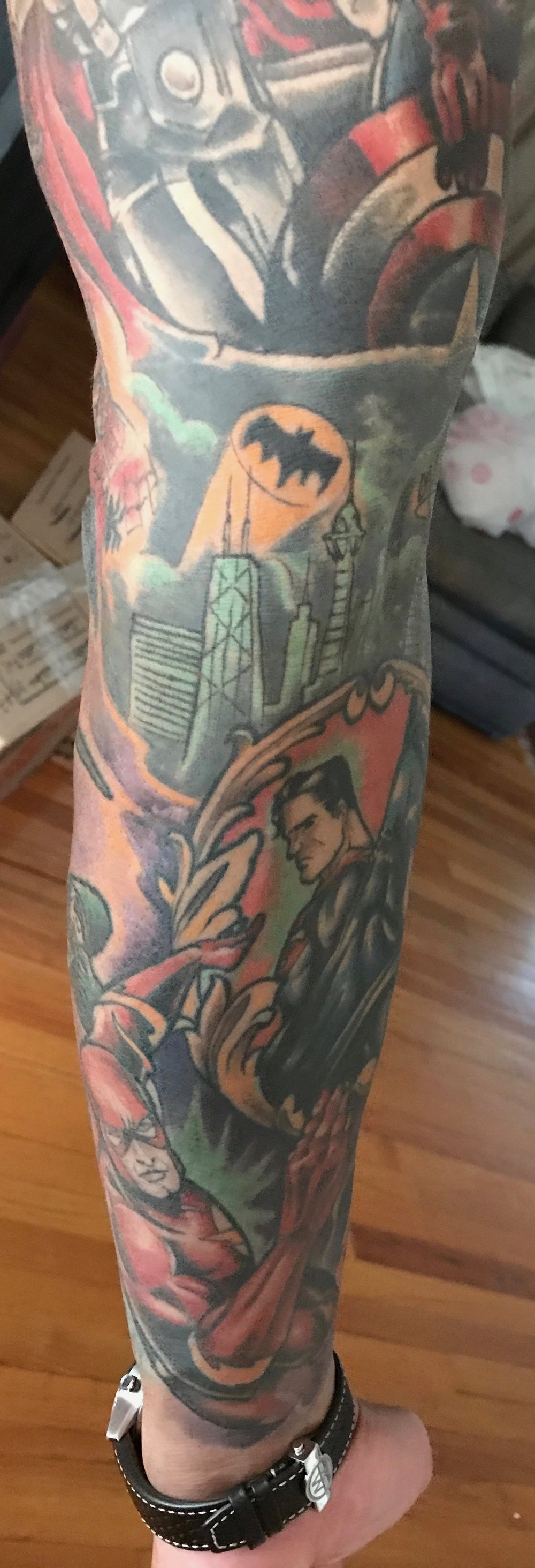 The upper part of the sleeve is an amazing cover up by Quori who transformed a botched tatoo into an amazing Avengers tattoo. A couple of years later I decided that it would be cool if I did the lower part of it entirely in DC heroes.