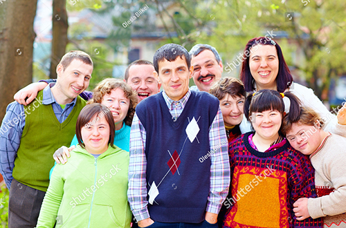 stock-photo-group-of-happy-people-with-disabilities-229283440.jpg