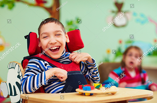 stock-photo-cheerful-boy-with-disability-at-rehabilitation-center-for-kids-with-special-needs-524271736(1).jpg