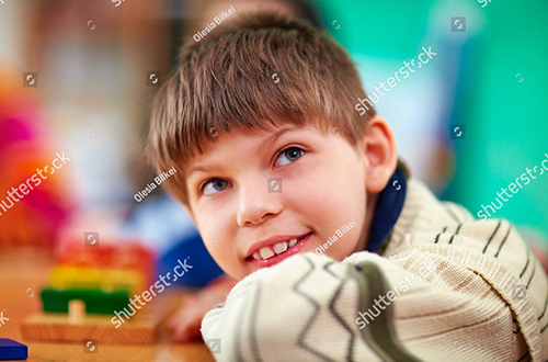 stock-photo-portrait-of-young-smiling-boy-kid-with-disabilities-352529054.jpg