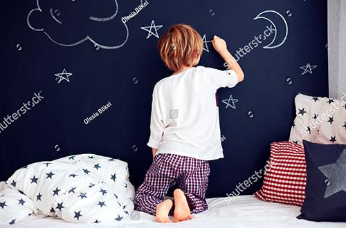 stock-photo-cute-kid-in-pajamas-painting-chalkboard-wall-in-his-bedroom-553137949.jpg