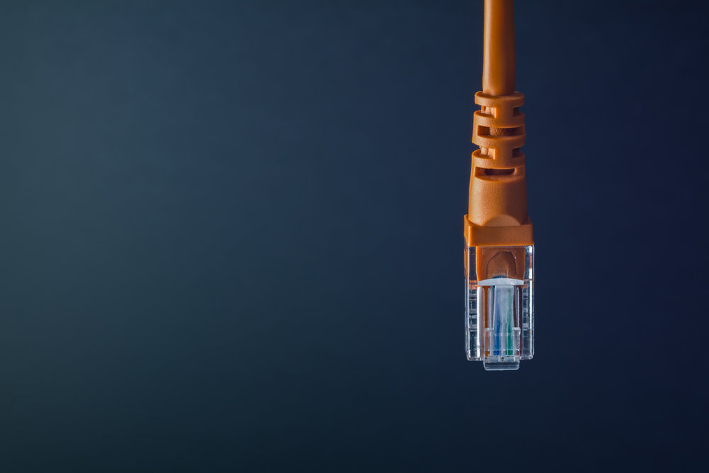 Home-Networking-RJ45-ethernet-data-cable-orange-pvc-sleeve-T568B-Grey-background