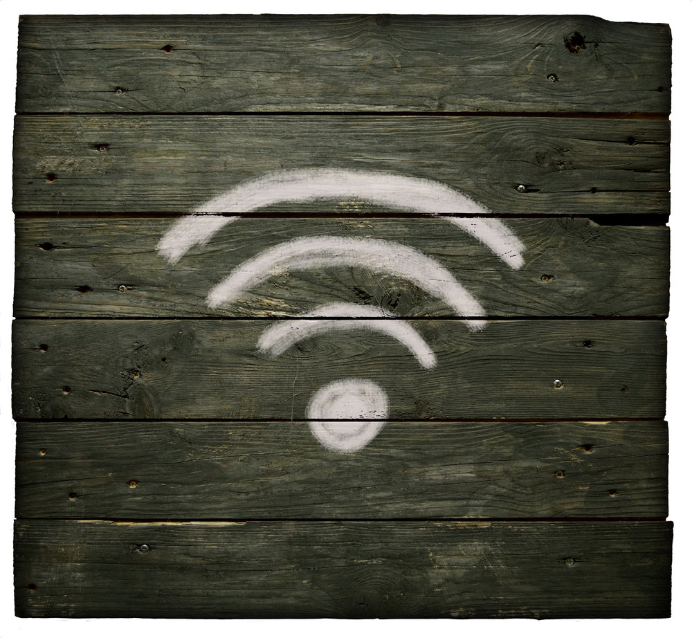 Wifi symbol on dark wood white chalk Home Networking