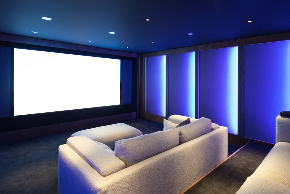Home-Cinema-Hawkshill-Way-Esher-Blue-walls-Cream-Sofas