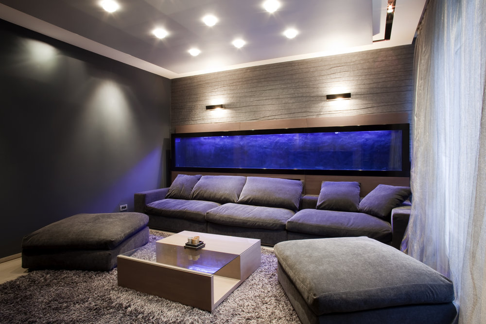 Home-cinema-snug-room-comfy-dark-blue-sofas