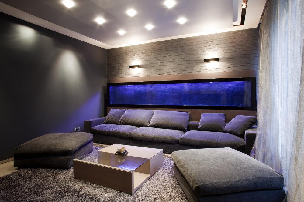 Home-cinema-snug-room-comfy-dark-blue-sofas