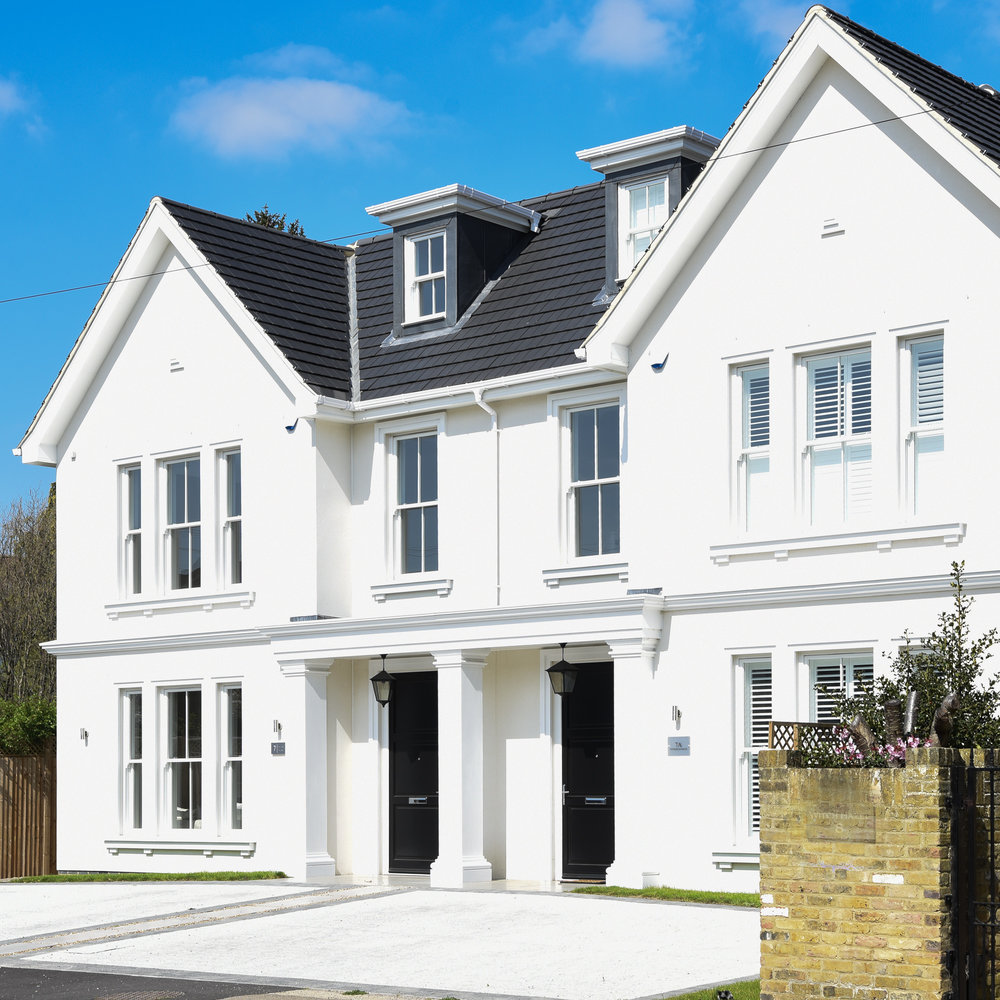 Luxe_Smart_Homes_Thames_Ditton_White_ Exterior_New Build_Grey_Roof_Blue_Sky.jpg