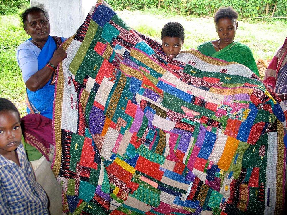 Quilters showing work, Mainalli village