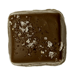 Milk Fleur de Sel Caramel - Luscious caramel with a hint of honey, dipped in milk chocolate with a sprinkle of French sea salt