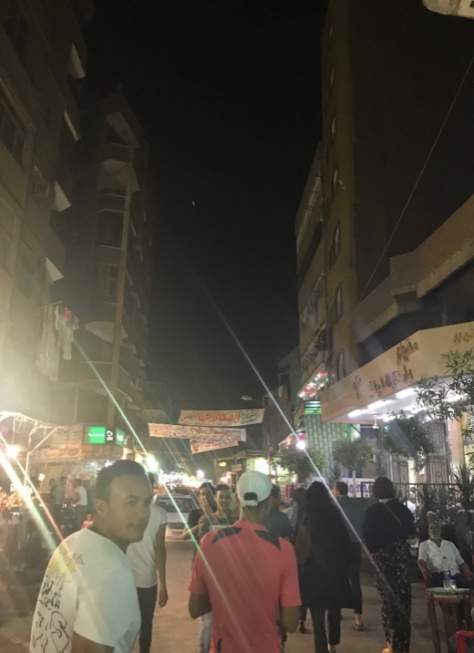 Nightlife on a street in Giza.