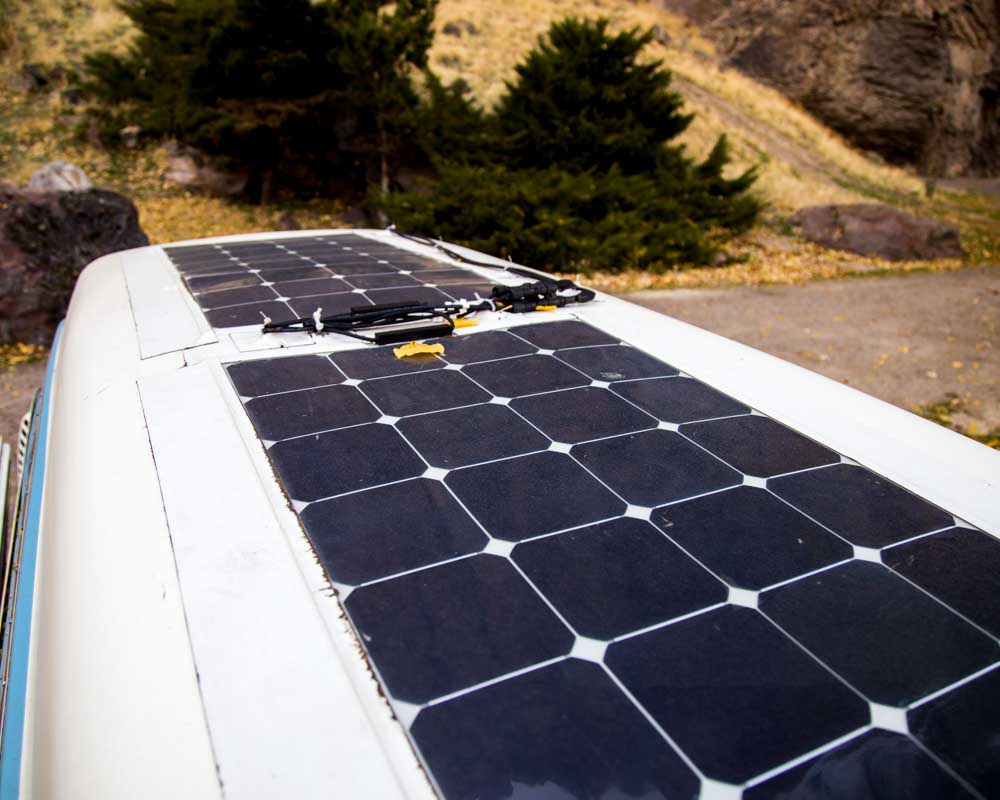 4 - Solar panels  - Initially we didn't have solar panels but after a year of running out of power and having to drive just to recharge the battery, we installed 200W of Flexible Solar Panels  on the roof of our VW Bus (video coming soon). It's a game changer getting power just by sitting in the sun. We run the fridge all day now and can charge our laptops, camera equipment, and phones at the same time.