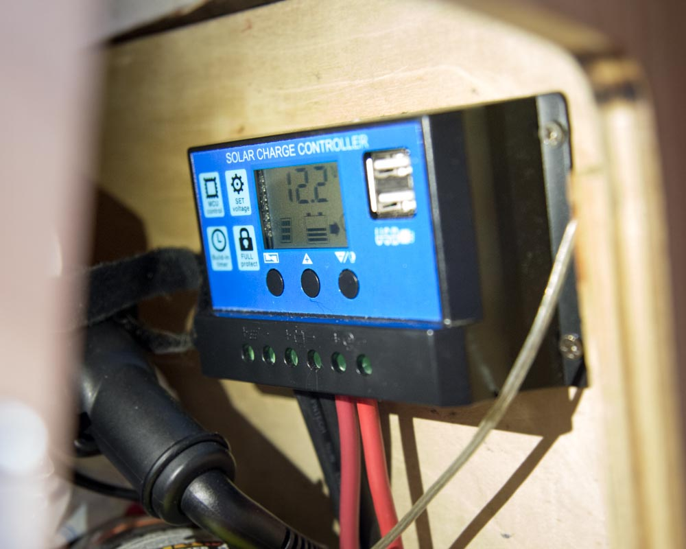 5 - Solar charge controller - The Solar Charge Controller monitors the voltage moving from the solar panels to the battery and to the power inverter. It's cheap, easy to install, and has two usb ports.