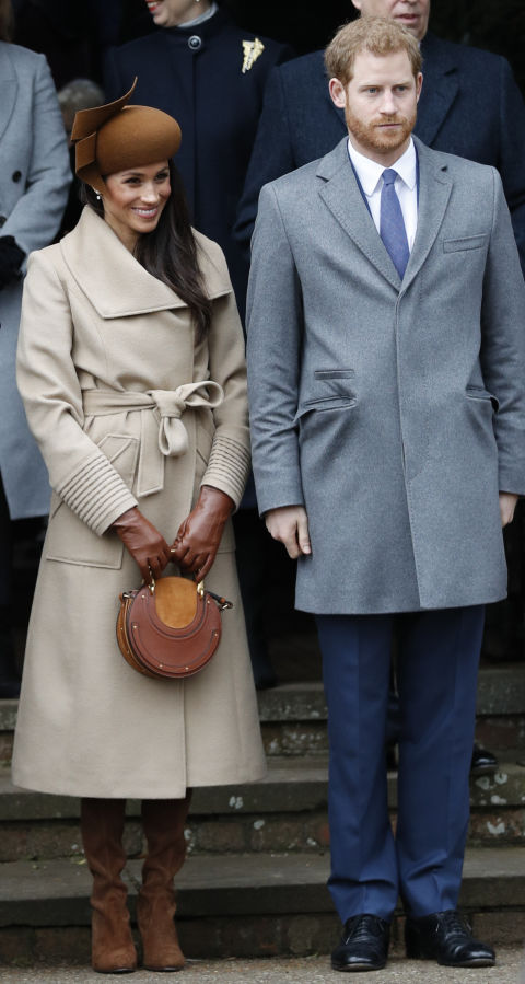 Markle wore a Philip Treacy felt hat, a Sentaler wide-collar camel coat and a burgundy  'Tay' velvet dress  from Canadian clothes brand Club Monaco for Christmas lunch and a church service in Sandringham.