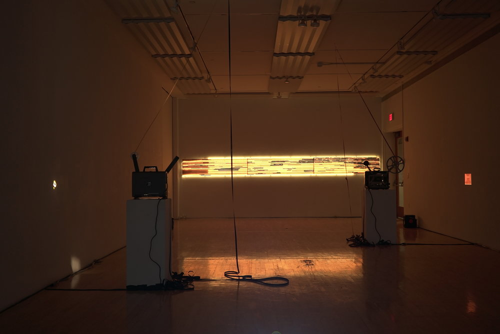 Sept 2017. 16mm film and 18'x2' vertical light table. Olive Tjaden Gallery. Installation view, east wall.