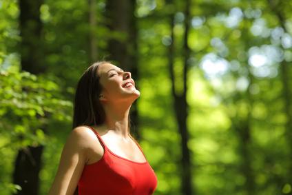 Woman_eyes_closed_enjoying_nature.jpg