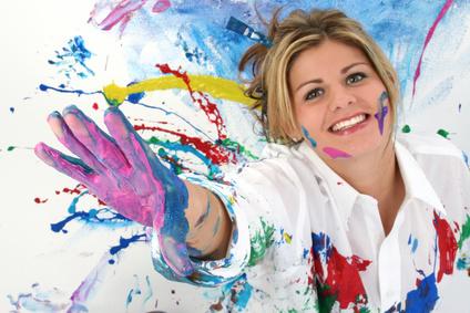 woman_spread_paint_colors_hands.jpg