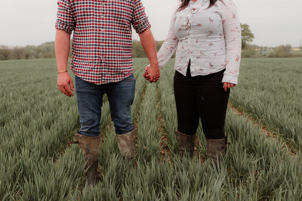 holding hands in field