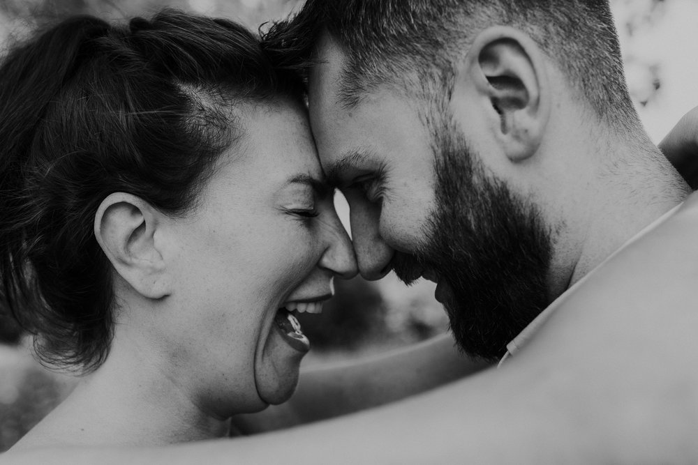 black and white couple laughing