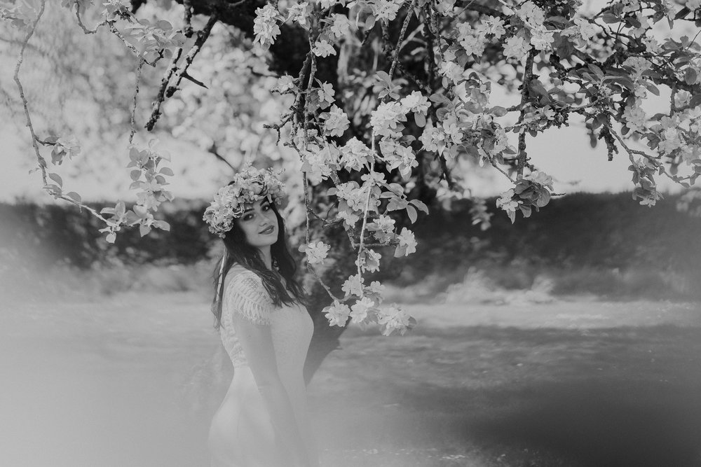 Bride in front of blossom tree