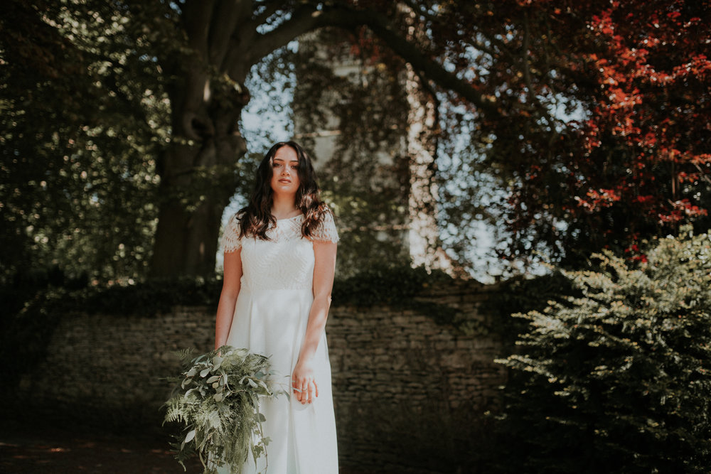 Bride in front of church under trees