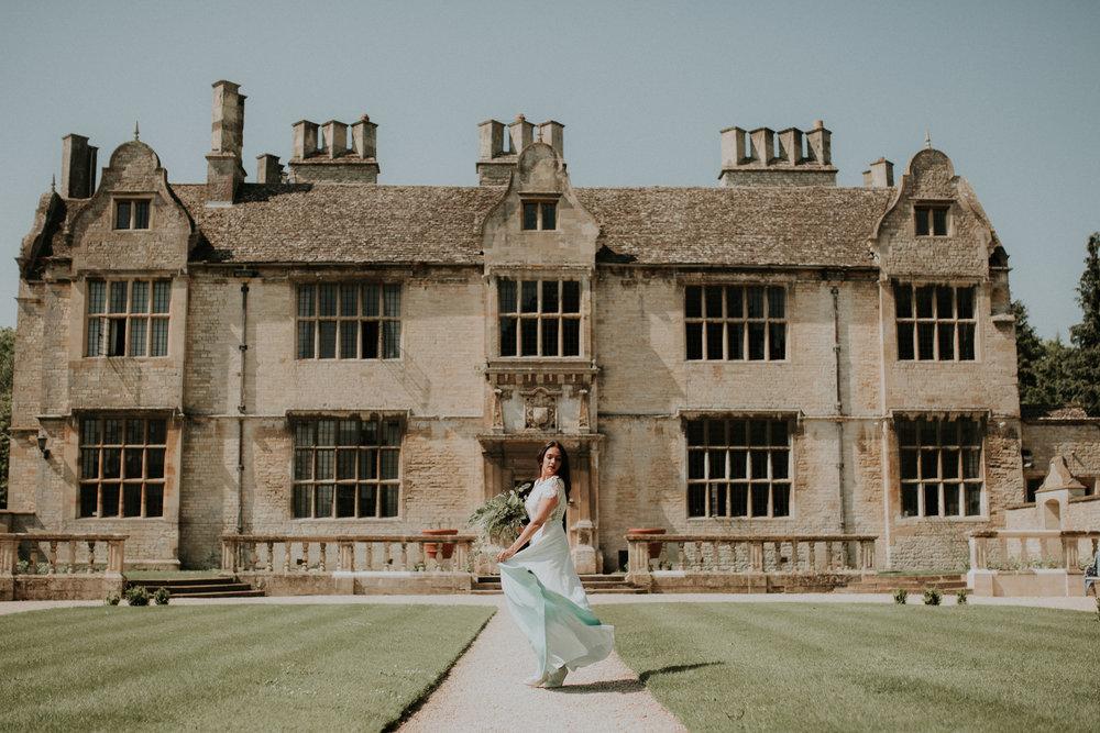 Boho Bride in front of Yarnton Manor