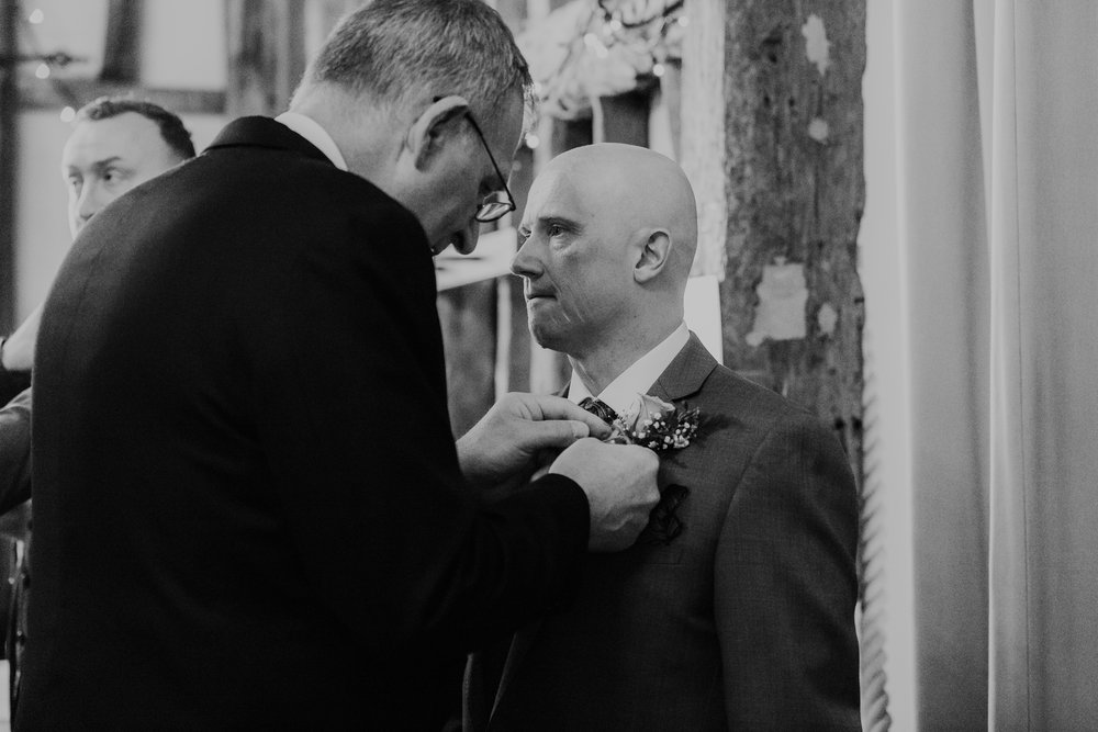 Andy getting ready whilst waiting for his Bride Laura to arrive for their barn wedding at The Olde Bell Hurley, photographed by Maya.