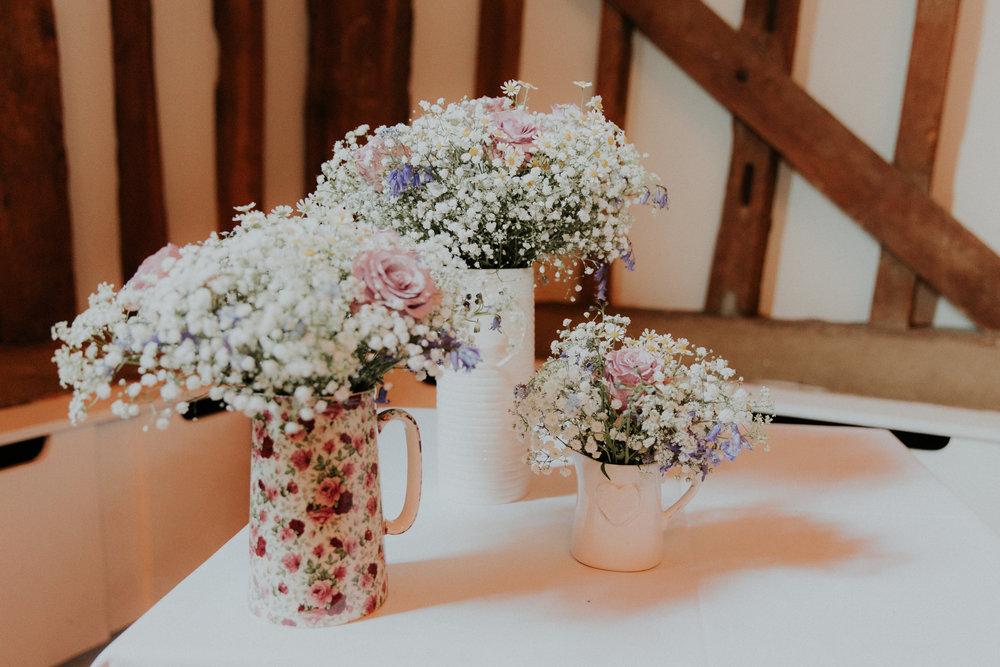 wildflower wedding flowers in jugs