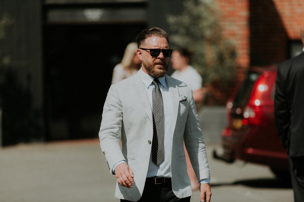 wedding guests in suit