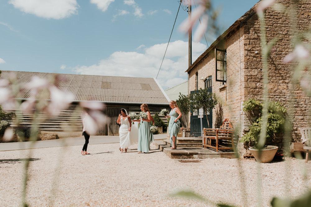 Bride walking to ceremony Merriscourt