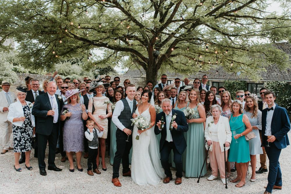wedding group photo under tree Merriscourt