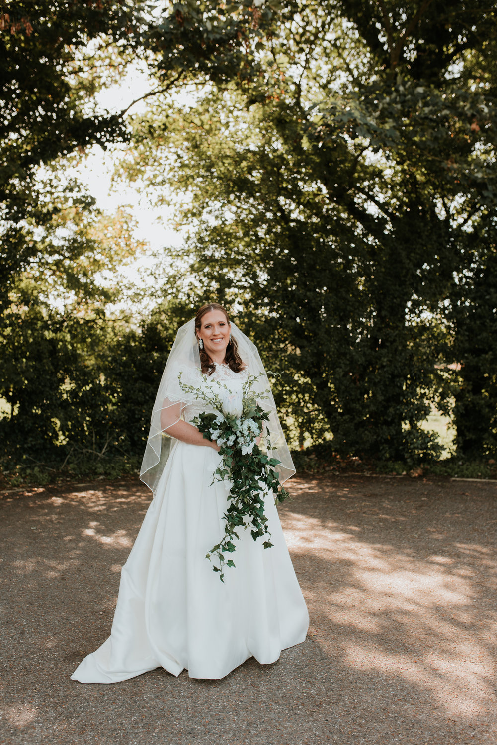 Bride with large spray bouquet