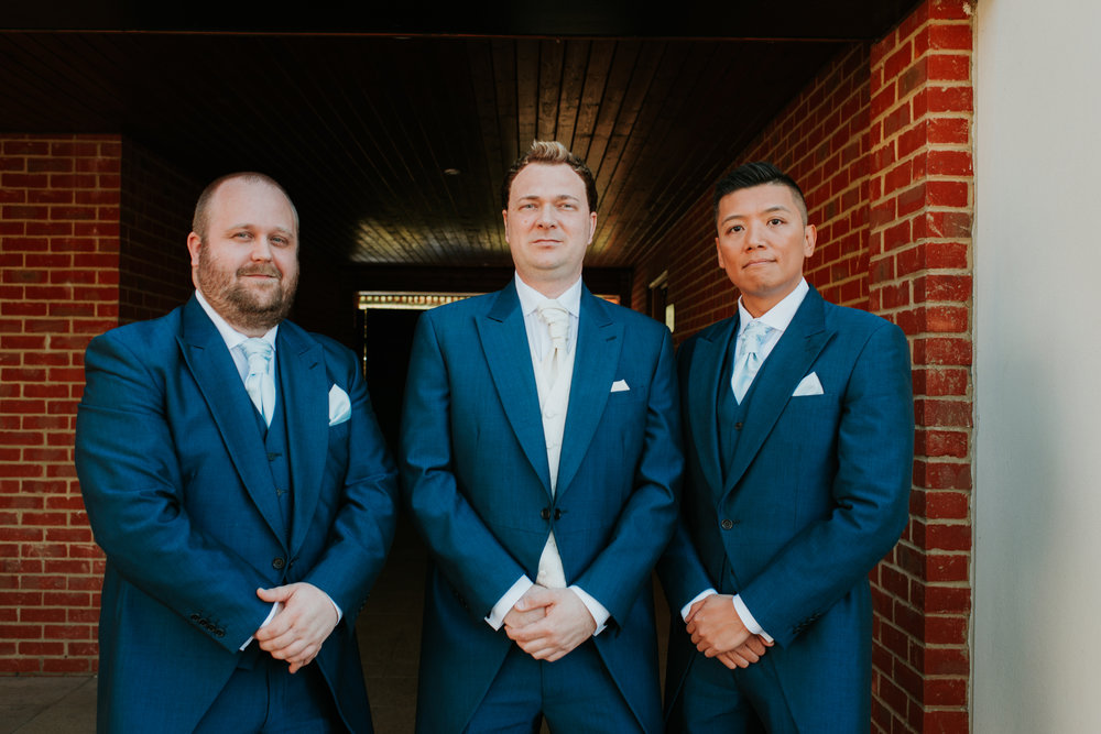 Groom with ushers in navy suits