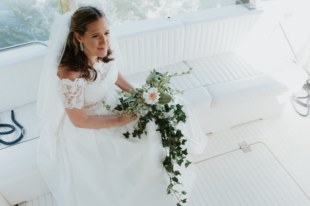 Bride with bouquet on boat
