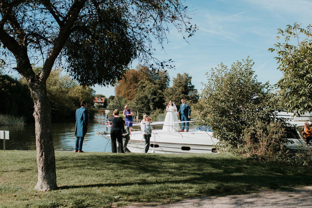 Bride arriving by boat Great House Sonning