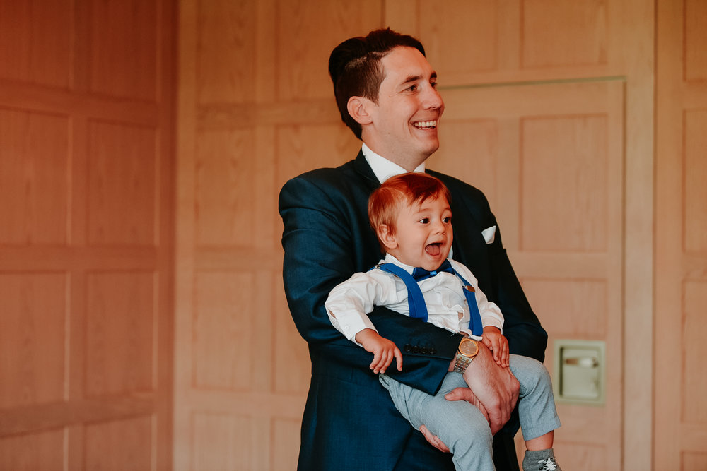 Happy toddler wedding guest