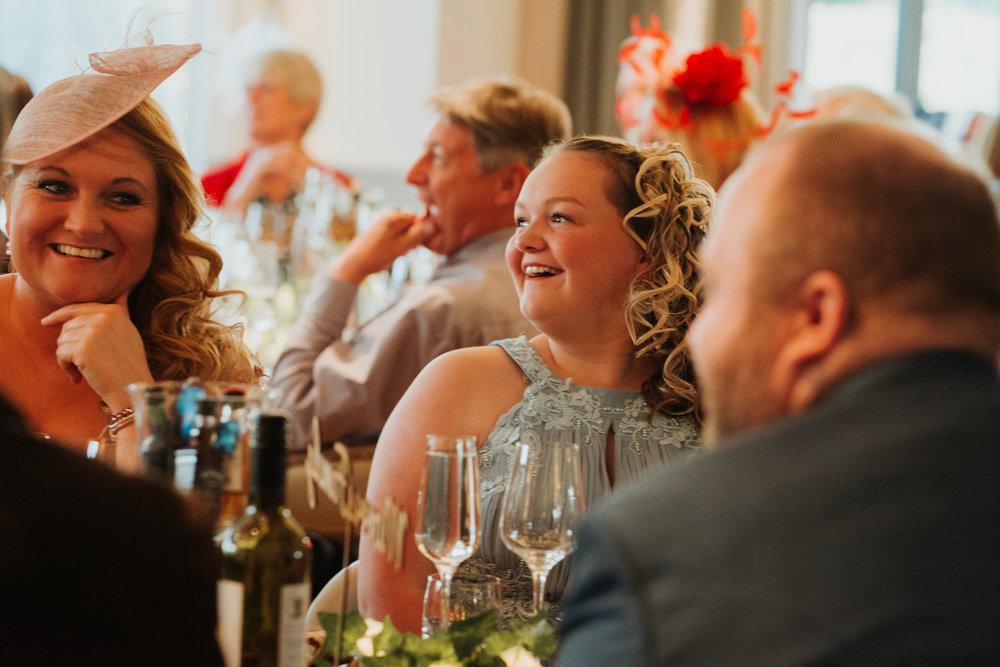 wedding guest laughing at best man speech
