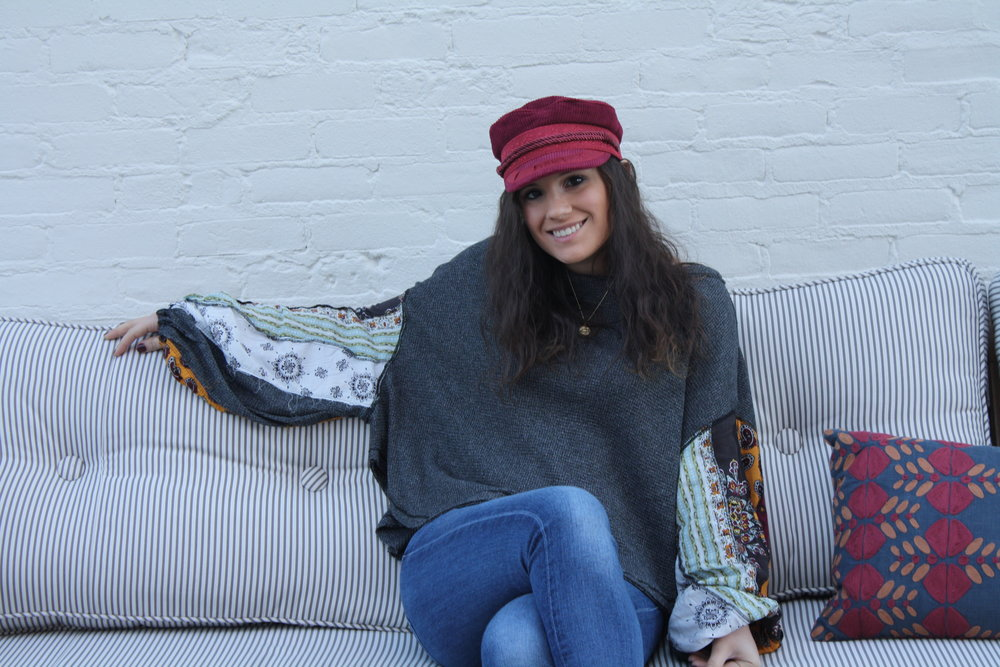 Hat: Brtixton from UO; Shirt: Free People; Jeans: 7 for All Mankind