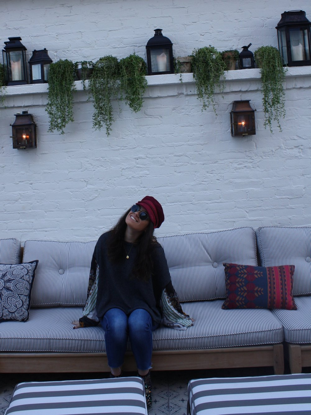 Hat: Brtixton from UO; Shirt: Free People; Jeans: 7 for All Mankind; Sunglasses: Ray-Ban