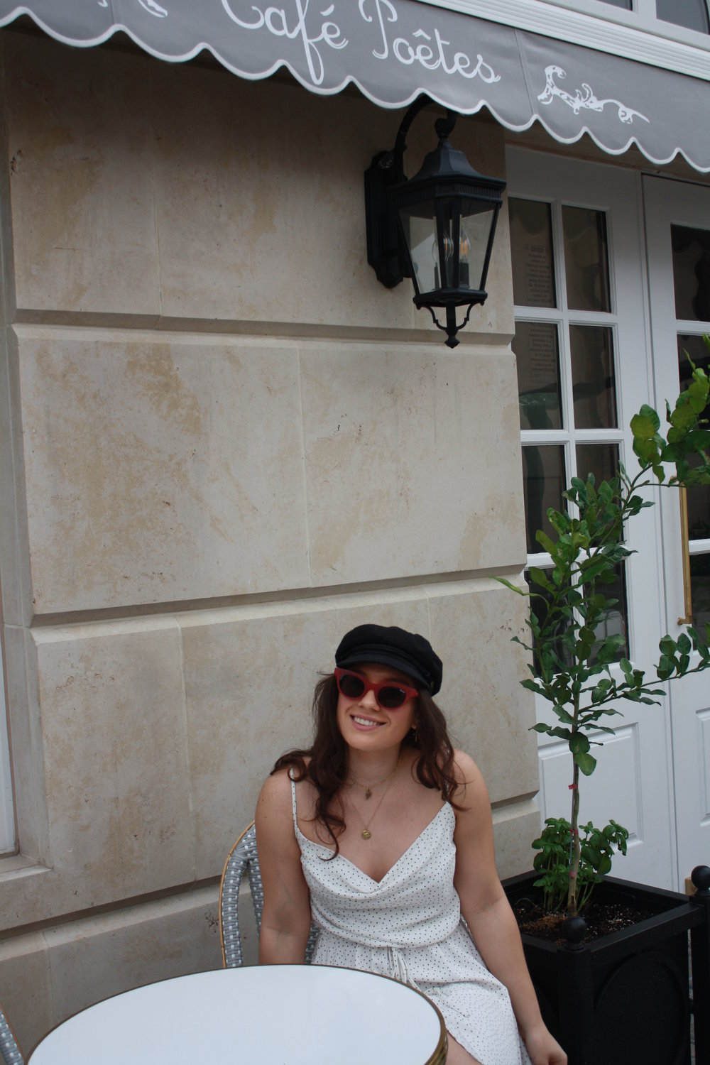 Hat: Brixton; Sunglasses: Quay; Jewelry: Frasier Sterling and Child of Wild; Dress: MinkPink
