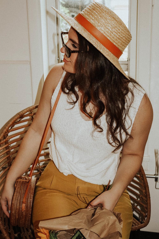 Hat: Lack of Colors; Sunglasses: Amuse Society X D'Blanc; Top: Moon River; Pants: Lost + Wander;Purse: Cleobella