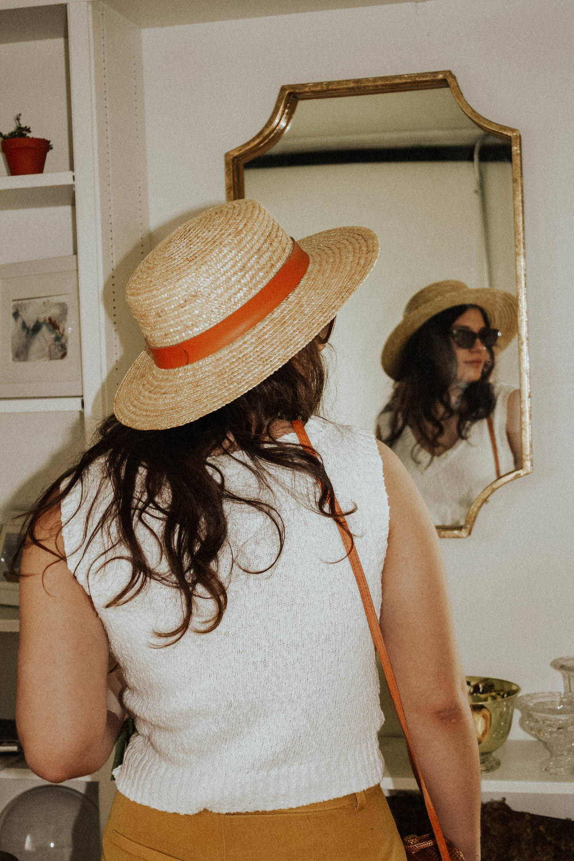 Hat: Lack of Colors; Sunglasses: Amuse Society X D'Blanc; Top: Moon River